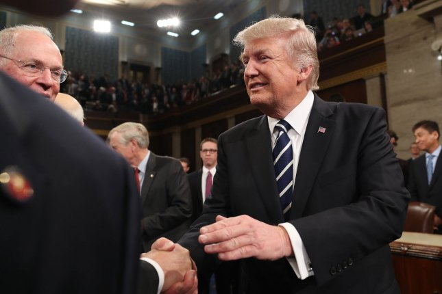 President Donald J. Trump shakes hands on his way out after delivering his first address to a joint session of Congress from the floor of the House of Representatives in Washington, D.C. on Tuesday. Pool Photo by Jim Lo Scalzo/UPI