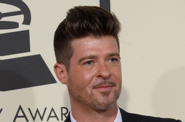 Robin Thicke and Pharrell Williams will still have to pay $5.3 million in damages after an appeals court upheld a decision on their song Blurred Lines. File Photo by Jim Ruymen/UPI