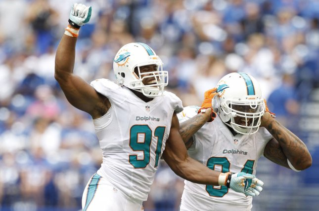 Miami Dolphins defenders Cameron Wake (91) and Randy Starks (94) celebrate a sack of Indianapolis Colts quarterback Andrew Luck in the fourth quarter on September 15, 2013 at Lucas Oil Field in Indianapolis, Indiana. File photo by Mark Cowan/UPI