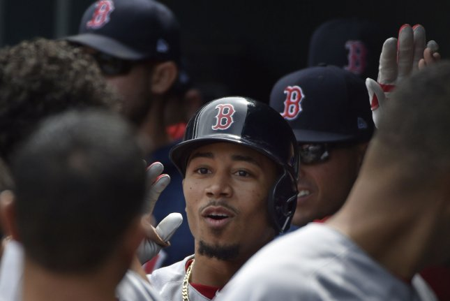 Boston Red Sox batter Mookie Betts (C). Photo by David Tulis/UPI