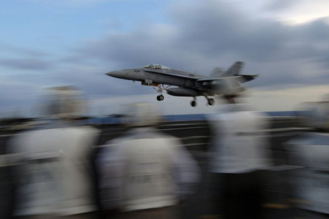 An F/A-18 Super Hornet assigned to Fighter Attack Squadron Thirty Seven Raging Bulls lands on the flight deck of the aircraft carrier USS Harry S. Truman in 2009. Daron Street/U.S. Navy