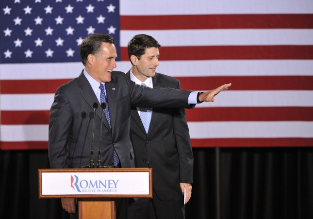 Republican Presidential hopeful Mitt Romney (L) waves as he stands with Rep. Paul Ryan (R-WI) after being introduced at a rally on April 3, 2012 in Milwaukee, Wisconsin. Wisconsin, along with Maryland and Washington D.C. held their primary elections on Tuesday. UPI/Brian Kersey
