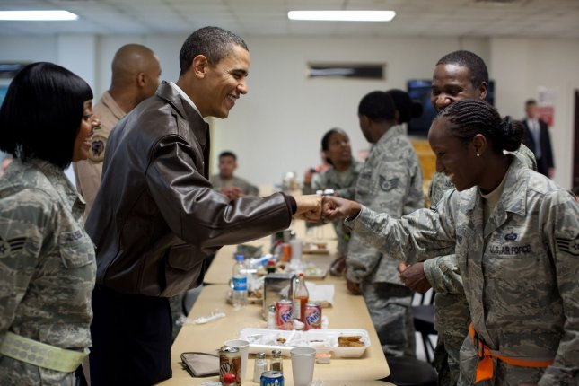 U.S. President Barack Obama greets U.S. troops at Bagram Air Field in Afghanistan, March 28, 2010 The unannounced visit to Afghanistan was Obama's first as president. UPI/Pete Souza/White House.House.