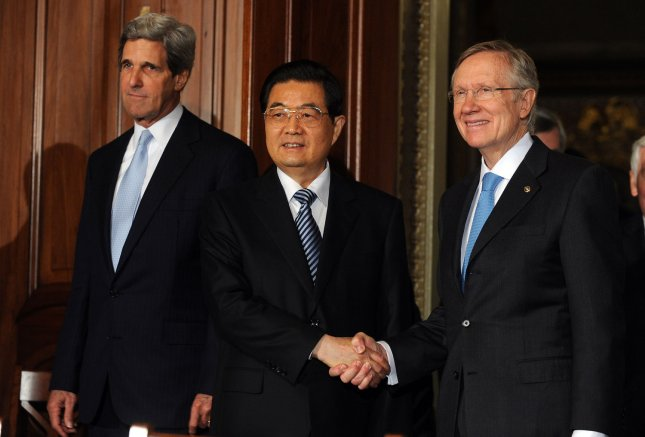 President Hu Jintao of the People's Republic of China shakes hands with Senate Majority Leader Harry Reid, D-NV, as Sen. John Kerry, D-MA, enters before their meeting on Capitol Hill in Washington on January 20, 2011. UPI/Roger L. Wollenberg