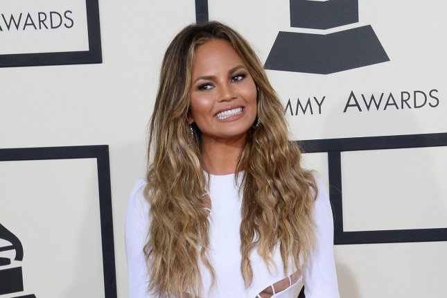 Model Chrissy Teigen arrives for the 57th Grammy Awards at Staples Center in Los Angeles on February 8, 2015. The self-proclaimed foodie recently posted a top-down photo on Instagram showing off her stretchies and bruises from banging drawers in her kitchen. Photo by Jim Ruymen/UPI
