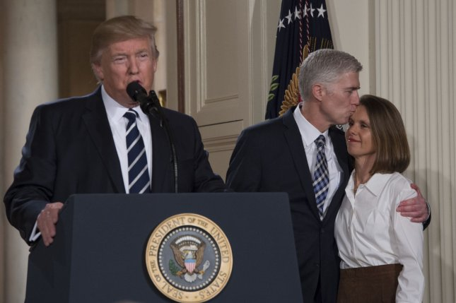 Judge Neil McGill Gorsuch kisses his wife Louise while being introduced by President Donald Trump as his nominee for the U.S. Supreme Court in the East Room of the White House on Tuesday night. Photo by Molly Riley/UPI