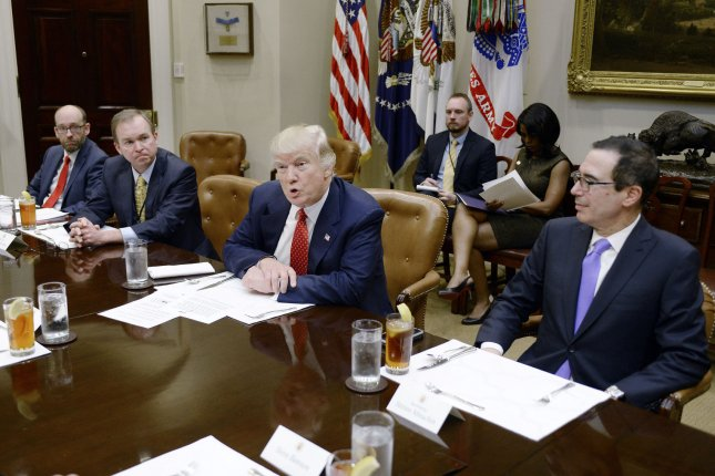 President Donald Trump discusses his upcoming federal budget as Treasury Secretary Steve Mnuchin (R) looks on at a business lunch in the Roosevelt Room of the White House on Wednesday. Pool Photo by Olivier Douliery/UPI