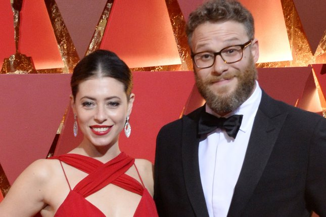 Seth Rogen (R) and Lauren Miller arrive on the red carpet for the 89th annual Academy Awards on February 26. Rogen will be voicing Pumbaa alongside Billy Eichner as Timon in The Lion King. File Photo by Jim Ruymen/UPI