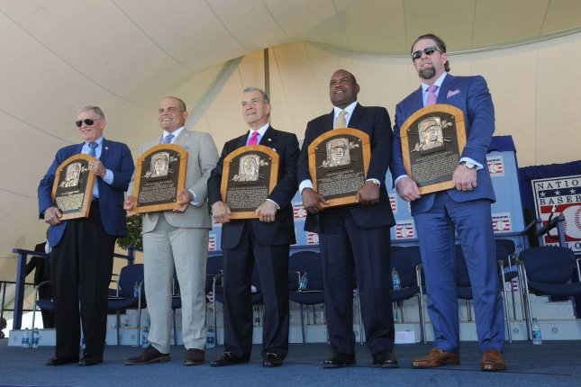 Bud Selig, Ivan Rodriguez, John Scherholz, Tim Raines and Jeff Bagwell hold their plaque at the Baseball Hall of Fame induction ceremony in Cooperstown, NY on July 30, 2017. Jeff Bagwell, Tim Raines and Ivan Rodr'guez join John Schuerholz and Bud Selig as the Class of 2017. Photo by George Napolitano/UPI