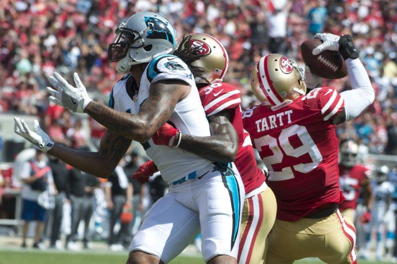 5fe162111a9 San Francisco 49ers Jaquiski Tartt (29) intercepts a pass from Carolina  Panthers QB Cam Newton to WR Kelvin Benjamin (L) in the second quarter at  Levi s ...