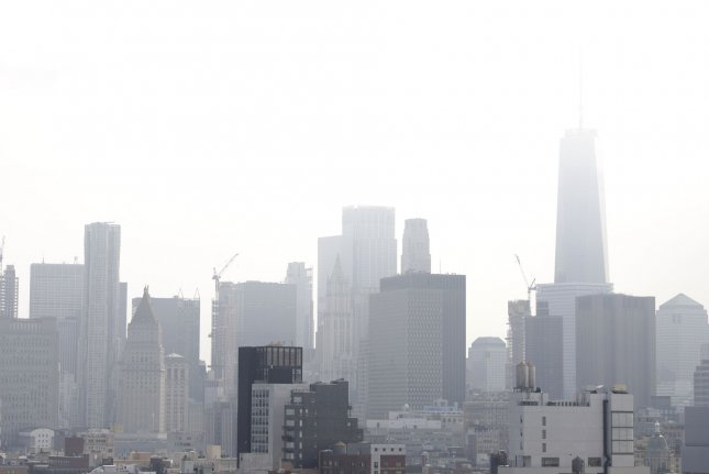 Haze surrounds One World Trade Center and the Manhattan skyline on a high humidity summer day in New York City on Thursday. The tri-state area is bracing for the worst potential heat wave of the year with temperatures expected to reach near 100 degrees Fahrenheit on Saturday. Photo by John Angelillo/UPI
