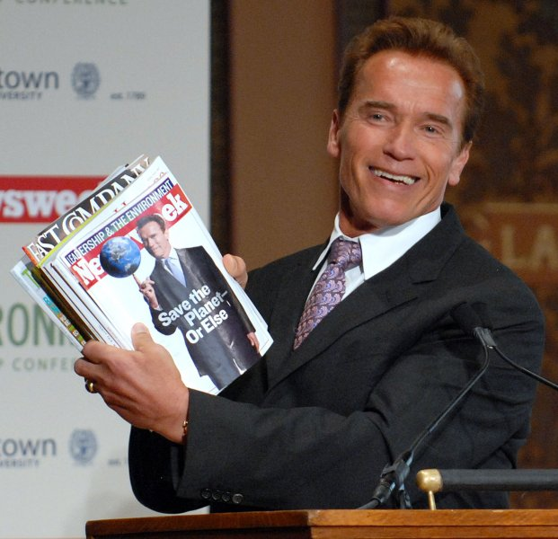 Republican California Governor Arnold Schwarzenegger holds up a copy of Newsweek which features Schwarzenegger balancing the Earth on his finger on the cover as he delivers the keynote address for Newsweek's Global Environmental Leadership Conference at Georgetown University in Washington on April 11, 2007. (UPI Photo/Roger L. Wollenberg)