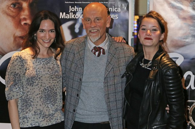 Kate Lindsey (L), John Malkovich (C) and Anna Prohaska arrive at the French premiere of the film The Casanova Variations in Paris on November 3, 2014. File Photo by David Silpa/UPI