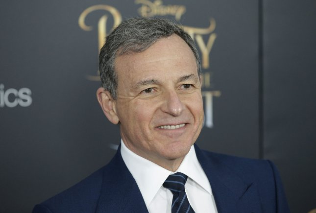 Disney CEO Bob Iger arrives on the red carpet at the Beauty and the Beast screening at Alice Tully Hall at Lincoln Center on March 13 in New York City. Disney announced Tuesday that it will remove all of its content from Netflix and begin a new streaming service to be launched in 2019. File Photo by John Angelillo/UPI