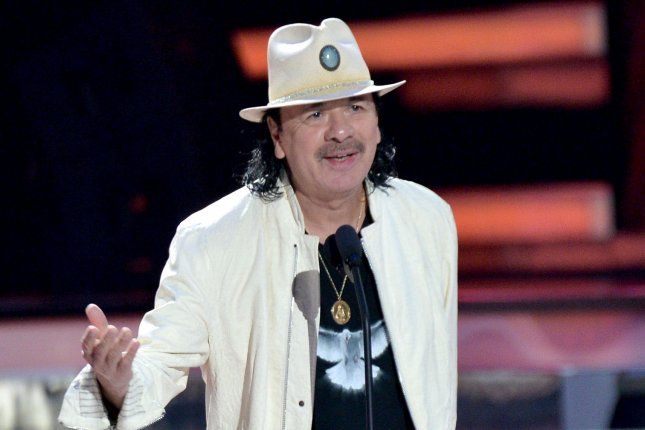Carlos Santana is set to on tour starting in June. File Photo by Jim Ruymen/UPI