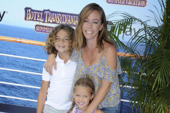 Kendra Wilkinson (R), pictured with son Hank (L) and daughter Alijah, said she's feeling good and focused on her kids following her split from Hank Baskett. File Photo by Patrick Rideaux/UPI