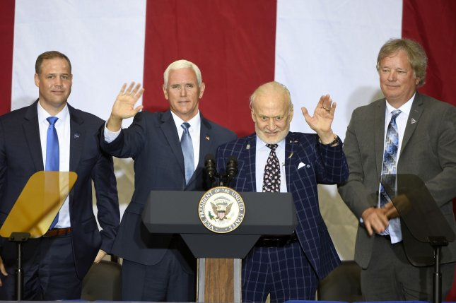NASA Administrator  Jim Bridenstine, Vice President Mike Pence, Astronaut Edwin E Buzz Aldrin and Rick Armstrong, son of Astronaut Neil Armstrong, mark the 50th Anniversary of Apollo 11 at Kennedy Space Center, Fla., on Saturday. Photo by Joe Marino/UPI