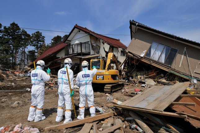 Japanese police wearing chemical protection suits search for victims inside the 20 kilometer radius around the Fukushima Dai-ichi nuclear power plant in Minamisoma, Fukushima prefecture, Japan, on April 15, 2011. A massive earthquake and ensuing tsunami on March 11 destroyed homes, killed thousands and caused a nuclear disaster. UPI/Keizo Mori
