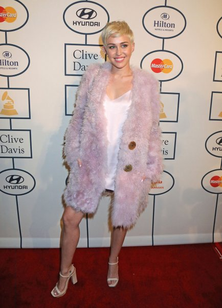 Miley Cyrus arrives on the red carpet before the annual Clive Davis Pre-Grammy Gala in Beverly Hills, California on January 25, 2014. UPI/David Silpa