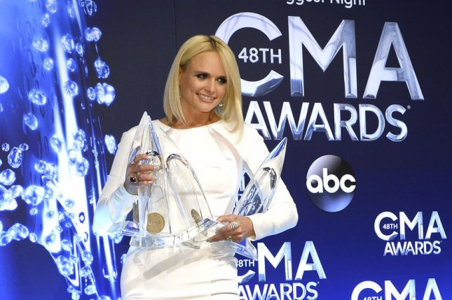 Miranda Lambert poses backstage after winning Female Vocalist of the Year, Single of the Year, Musical Event of the Year and Album of the Year at the 48th Annual Country Music Awards at the Bridgestone Arena in Nashville. UPI/David Tulis