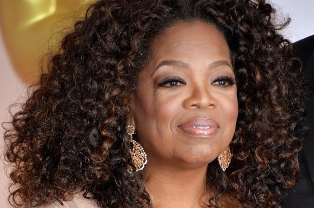 Oprah Winfrey arrives on the red carpet at the 87th Academy Awards in Los Angeles in 2015. File Photo by Kevin Dietsch/UPI