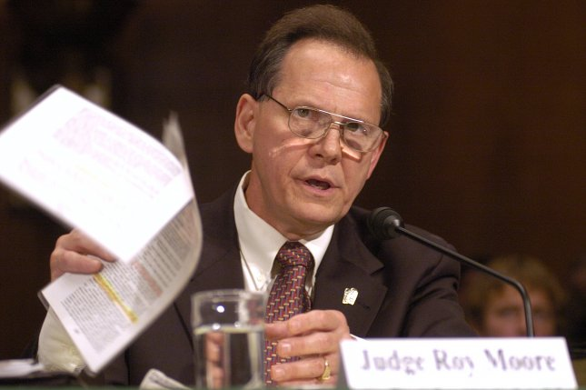 Roy Moore was removed as chief justice from the Alabama Supreme Court for the remainder of his term on Friday for his efforts to block gay marriage in the state. Moore, who also was removed from his position in 2003 but reelected in 2012, is shown here testifying in 2004 before the Senate Judiciary Committee on the U.S. Constitution and Public Religious Expression. File photo by Greg Whitesell/UPI