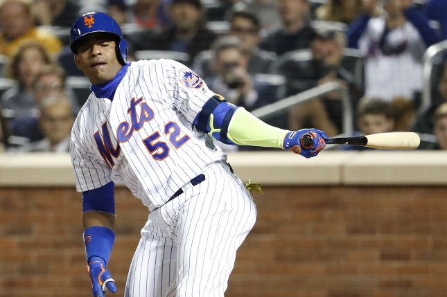 New York Mets' Yoenis Cespedes reacts after swinging at a pitch in the 4th inning against the San Francisco Giants in the National League Wild-Card game at Citi Field in New York City on October 5, 2016. The winner will go on to face the Chicago Cubs in the NLCS. Photo by John Angelillo/UPI