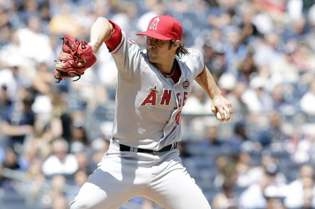 Los Angeles Angels starting pitcher C.J. Wilson throws a pitch in the second inning against the New York Yankees at Yankee Stadium in New York City on August 15, 2013. UPI/John Angelillo