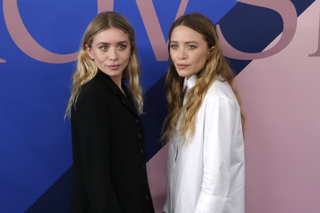 Mary-Kate Olsen (L) and Ashley Olsen attend the CFDA Fashion Awards on Monday. Photo by John Angelillo/UPI