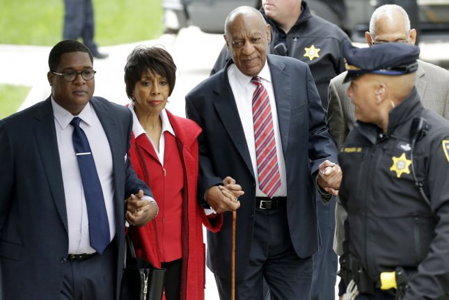 Bill Cosby is escorted into Montgomery County Courthouse for the third day of his sexual assault trial in Norristown, Pa., on Wednesday. On Tuesday, Cosby's accuser, Andrea Constand, took the stand to describe the alleged 2004 sexual assault. Photo by John Angelillo/UPI