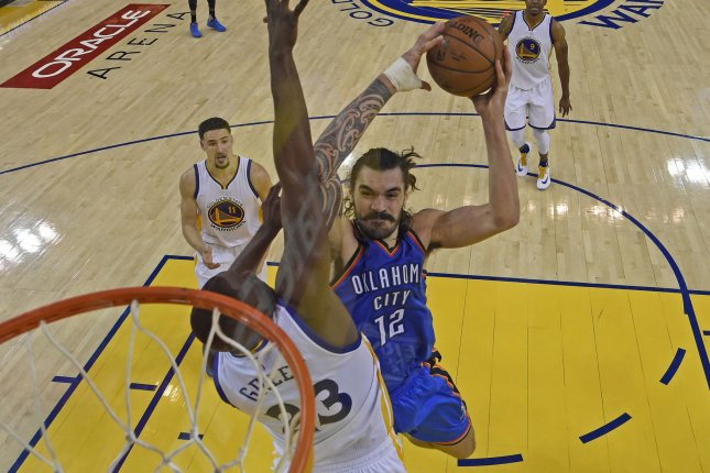 Oklahoma City Thunder center Steven Adams (12) goes up for a dunk against Golden State Warriors forward Draymond Green (23) in the fourth quarter of Game 1 of the NBA Western Conference finals on May 16, 2016 at Oracle Arena in Oakland, California. Pool photo by Jose Carlos Fajardo/UPI