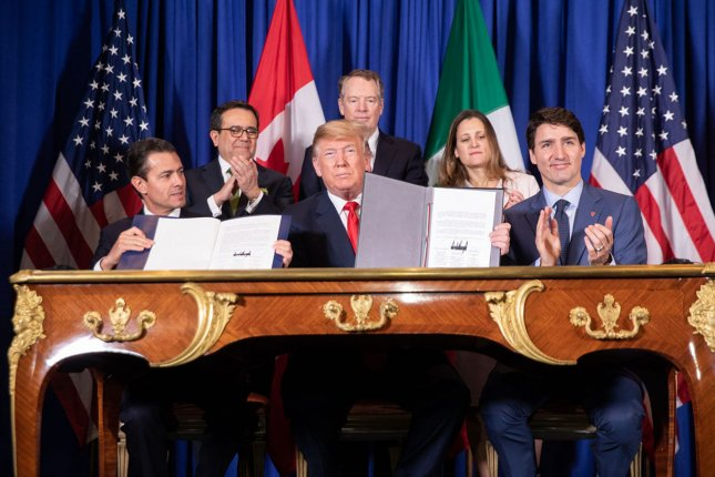 President Donald Trump is joined by Mexican President Enrique Pena Nieto (L) and Canadian Prime Minister Justin Trudeau (R) at the USMCA signing ceremony on Friday, in Buenos Aires. Photo by Shealah Craighead/White House/UPI