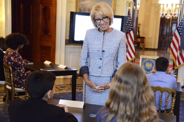 Education Secretary Betsy DeVoss visits with students at the White House on April 9, 2018. File Photo by Mike Theiler/UPI