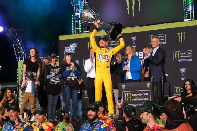 Kyle Busch celebrates winning his second Monster Energy NASCAR Cup Series Championship at the 2019 Ford EcoBoost 400 Cup Series Championship on Sunday at Homestead-Miami Speedway in Homestead, Florida. Photo By Gary I Rothstein/UPI