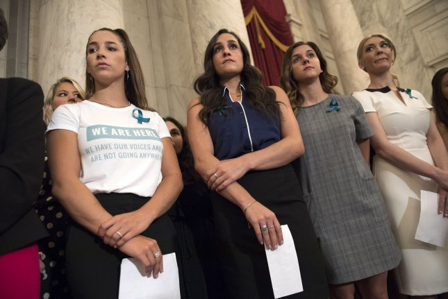 Aly Raisman, two time Olympian and victim of former Team USA Olympic doctor Larry Nassar, stands with fellow victims during a press conference on abuse within gymnastics and youth sports and the necessary reforms needed to keep young athletes safe, on July 24, 2018. File Photo by Kevin Dietsch/UPI
