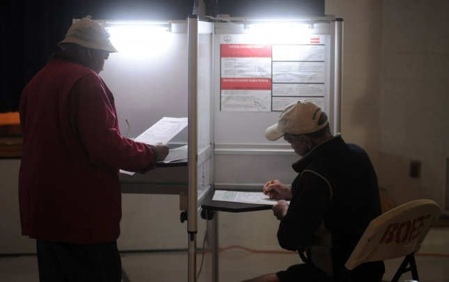 District of Columbia residents cast their votes at a polling location on election day in Washington on November 4, 2008. The country cast their votes today to elect the forty-fourth President of the United States. (UPI Photo/Kevin Dietsch)