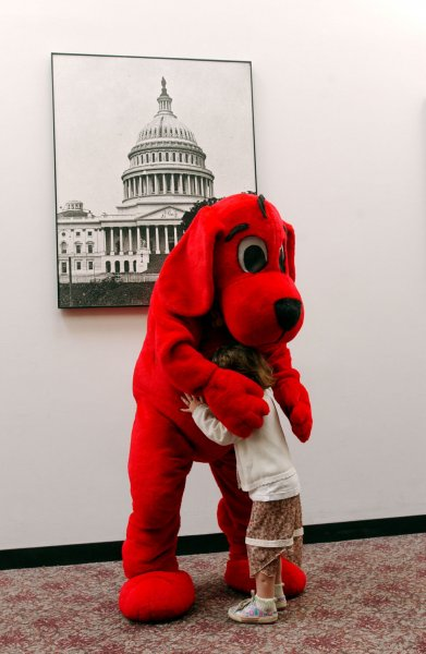 A child gets a big hug from Clifford the big red dog during a celebration of the 12th Annual Take Our Daughters and Sons to Work Day on April 28, 2005 in Washington. (UPI Photo/Michael Kleinfeld)..