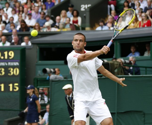 Mikhail Youzhny, shown in last year's Wimbledon tournament, won in striaght sets Friday and will play in the semifinals of rhe PBZ Zagreb Indoors. Youzhny is the defending champion of the event. UPI/Hugo Philpott