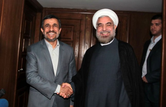 In this official handout image, Iran's outgoing president Mahmoud Ahmadinejad meets newly-elected president Hassan Rouhani in Tehran, Iran on June 18, 2013. UPI