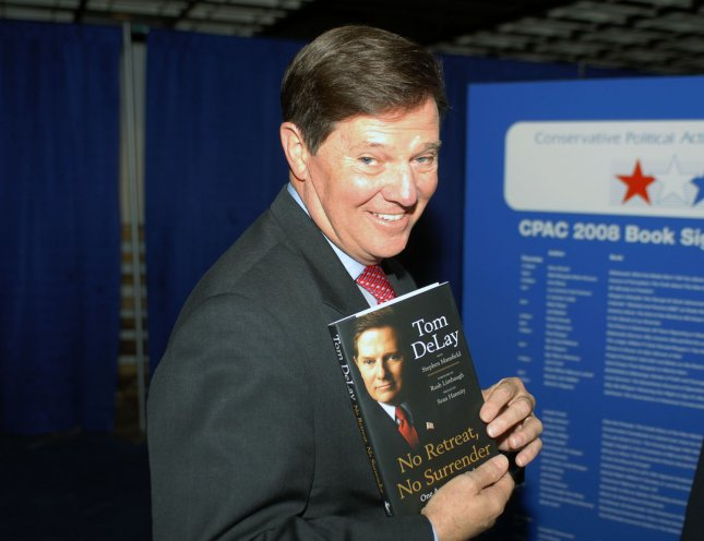 Former U.S. House Majority Leader Tom Delay, R-Texas, holds a copy of his book No Retreat, No Surrender: One American's Fight at the Conservative Political Action Conference in Washington, Feb. 8, 2008. (UPI Photo/Alexis C. Glenn)