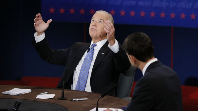 Vice-President Joe Biden (L) responds to Republican Vice-President nominee Paul Ryan at the Vice-Presidential debate at Centre College on October 11, 2012 in Danville, Kentucky. UPI/Rick Wilking POOL