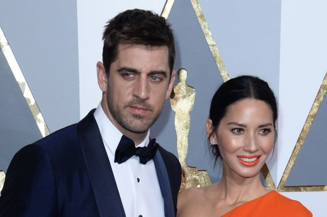 Olivia Munn (R) and boyfriend Aaron Rodgers at the Academy Awards on February 28. The couple have been together since 2014. File Photo by Jim Ruymen/UPI