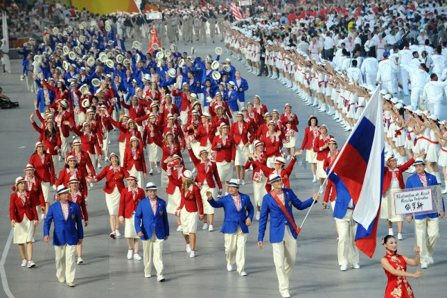 The Russian Olympic Team marches into National Stadium, also called the Bird's Nest, during the Opening Ceremonies for the 2008 Summer Olympics in Beijing, China, on August 8, 2008. The IOC has informed Russia that 14 athletes have tested positive for banned substances after re-testing. File photo by Pat Benic/UPI