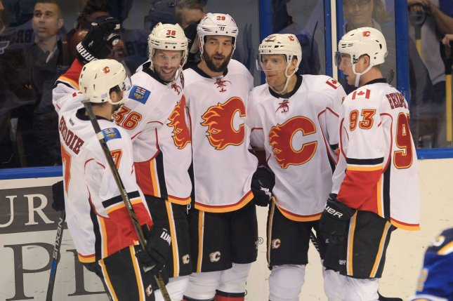 Caglary Flames (L to R) TJ Brodie, Troy Brouwer, Deryk Engelland, Kris Versteeg and Sam Bennett celebrate a Engelland goal, against the St. Louis Blues in the first period at the Scottrade Center in St. Louis on October 25, 2016. Photo by Bill Greenblatt/UPI
