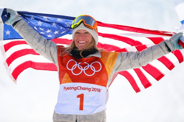 Jamie Anderson of the United States poses for a photo with an American flag after winning gold in the ladies' snowboard slopestyle final on day three of the 2018 Winter Olympics at Phoenix Snow Park in Pyeongchang, South Korea, Monday. Photo by Matthew Healey/UPI