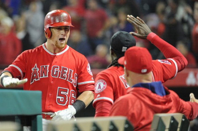 Los Angeles Angels' Kole Calhoun is congratulated by teammates after hitting a two run homer in the seventh inning against the Seattle Mariners. Photo by Lori Shepler/UPI