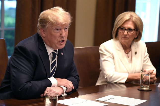 President Donald Trump (L) makes opening remarks during a meeting with members of Congress, including Rep. Diane Black, R-Tenn., on tax reform at the White House on Tuesday. Photo by Mike Theiler/UPI