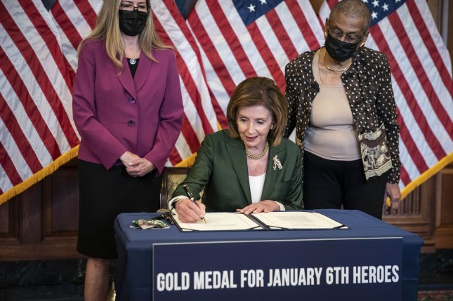 Rep. Jennifer Wexton, D-Va., House Speaker Nancy Pelosi, D-Calif., and Delegate Eleanor Holmes Norton, D-D.C., participate in a bill enrollment ceremony for H.R. 3325 at the U.S. Capitol in Washington D.C., on Wednesday. Photo by Sarah Silbiger/UPI
