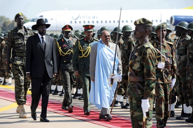 President Bashir and First Vice President and President of the Government of Southern Sudan Salva Kiir inspect an honour guard at Juba airport, in Juba, Sudan, on January 4, 2011. President Bashir visited Juba five days before the start of the long-awaited Southern Sudan referendum on self-determination. During the visit President Bashir discussed preparations for the plebiscite and other outstanding issues with his counterparts in the Government of Southern Sudan. UPI/Tim McKulka/UN
