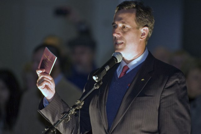 Rick Santorum waves a copy of the Declaration of Independence while campaigning in Tacoma, Wash., Feb.13, 2012.. UPI/Jim Bryant